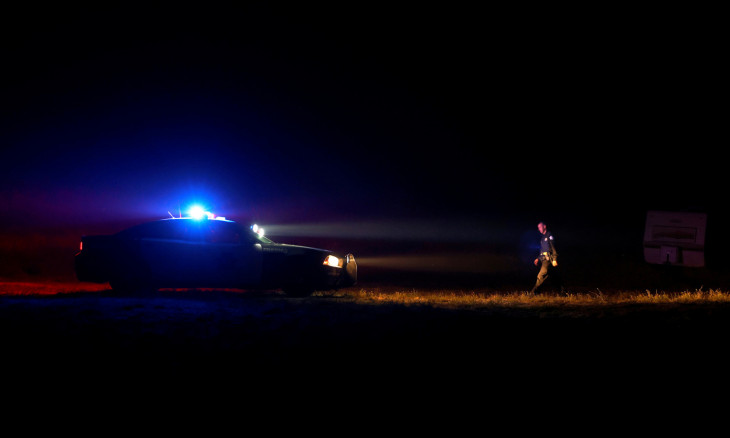 A police officer with the Fresno Police Department walks back to his vehicle