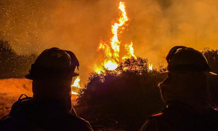 Firefighters work to extinguish a fire in Alpine, California, U.S