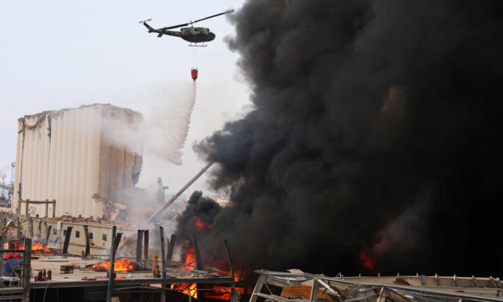 A helicopter tries to put out a fire