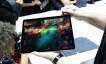 Attendees try out the new iPad Pro during an Apple launch event in the Brooklyn borough of New York