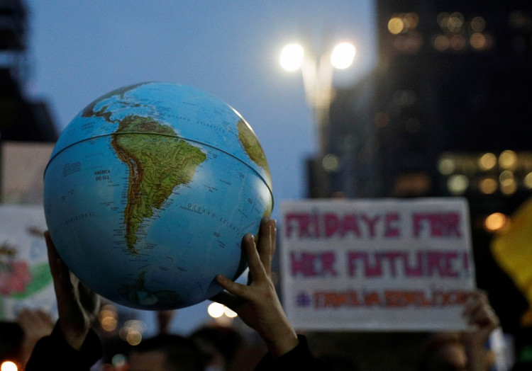 A person holds an earth globe during the Global Climate Strike of the Fridays for Future movement in Sao Paulo, Brazil September 20, 2019.