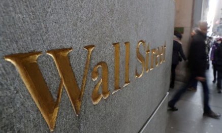 A street sign, Wall Street, is seen outside New York Stock Exchange (NYSE) in New York City, New York