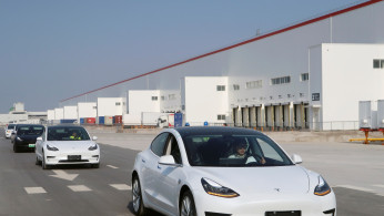 China-made Tesla Model 3 vehicles are seen at the Shanghai Gigafactory of the U.S. electric car maker in Shanghai