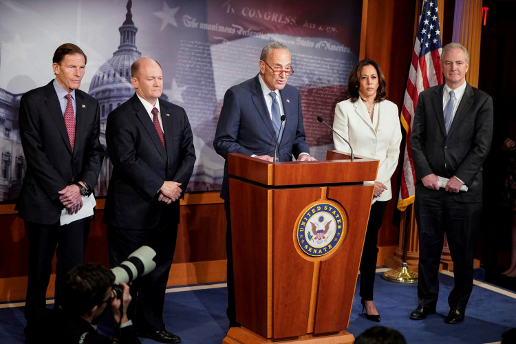 Senators Richard Blumenthal (D-CT), Chris Coons (D-DE), Senate Minority Leader Chuck Schumer (D-NY), Kamala Harris (D-CA) and Chris Van Hollen (D-MD) speak to journalists after the beginning of the impeachment trial of U.S. President Donald Trump