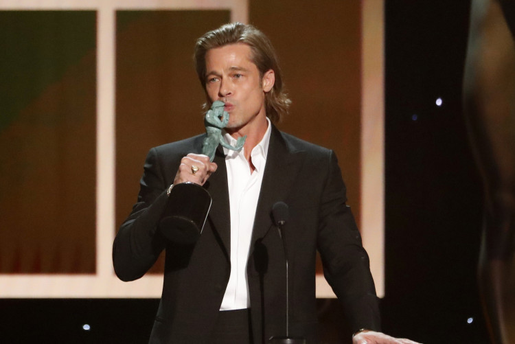 """26th Screen Actors Guild Awards - Show - Los Angeles, California, U.S., January 19, 2020 - Brad Pitt accepts the award for Outstanding Performance by a Male Actor in a Supporting Role for """"Once Upon A Time in Hollywood."""" REUTERS/Mario Anzuoni"""