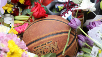 Basketball amid flowers at shrine for former Los Angeles Lakers basketball star Kobe Bryant arrive at a makeshift shrine in Los Angeles, California, U.S. January 26, 2020.