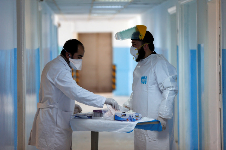 Members of the medical staff work at a new section specialised in receiving any person who may have been infected with coronavirus