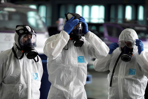 Members of the Thai Airways crew prepare themselves before disinfecting the cabin of an aircraft of the national carrier during a procedure to prevent the spread of the coronavirus at Bangkok's Suvarnabhumi International Airport