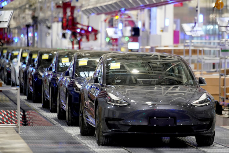 Tesla China-made Model 3 vehicles are seen during a delivery event at its factory in Shanghai, China