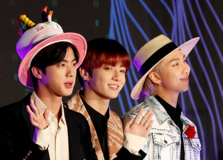 Jin, Jungkook, RM members of South Korean boy band BTS pose on the red carpet during the annual MAMA Awards at Nagoya Dome in Nagoya