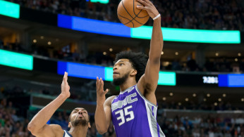 Sacramento Kings forward Marvin Bagley III (35) shoots the ball against Utah Jazz center Rudy Gobert (27)