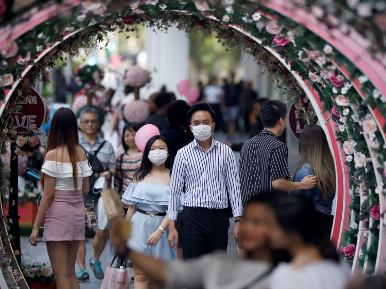 A couple celebrate Valentine's Day as they wear face masks in precaution of the coronavirus outbreak
