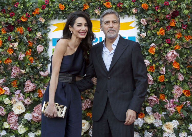 Amal and George Clooney arrive at People's Postcode Lottery's Charity Gala in Edinburgh's McEwan Hall on March 14, 2019. Postcode Lottery / Chris Watt Photography
