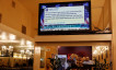A tweet by U.S. Donald Trump regarding the coronavirus is seen on a Chinese television station inside a restaurant in the Chinatown section of San Francisco, California
