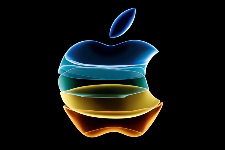 The Apple logo is displayed at an event at their headquarters in Cupertino