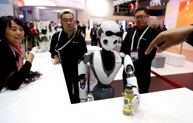 The CloudMinds XR-1 robot performs for visitors at the Mobile World Congress in Barcelona, Spain, Feb. 25, 2019.