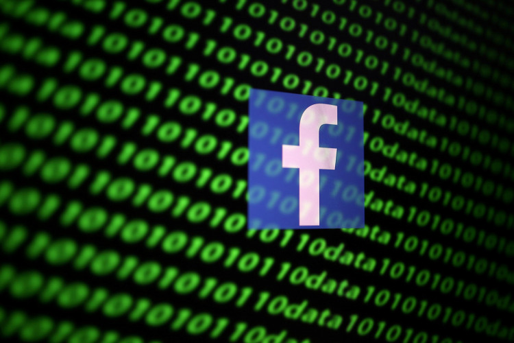 The Facebook logo and binary cyber codes are seen in this illustration taken November 26, 2019.