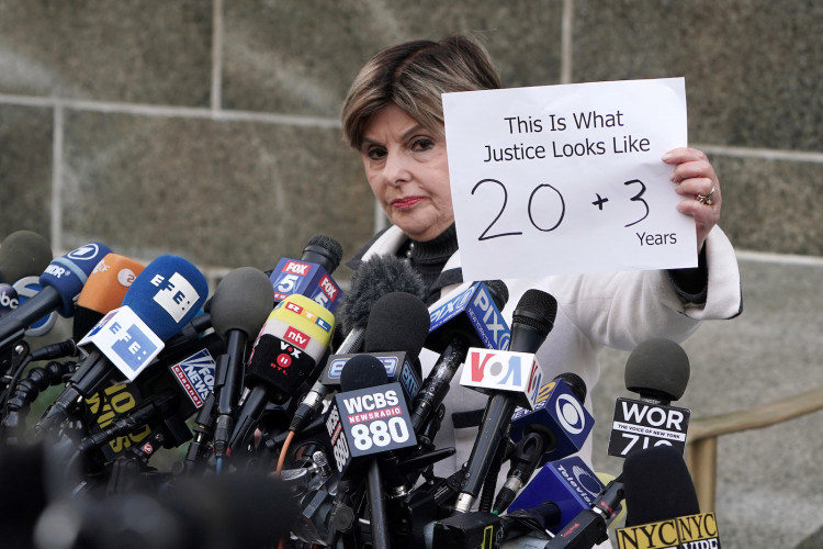 Lawyer for some victims of Harvey Weinstein Gloria Allred holds up a sign following his sentencing outside New York Criminal Court after his sexual assault trial in the Manhattan borough of New York City