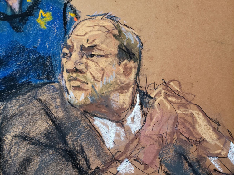 Harvey Weinstein watches as Jessica Mann makes a statement during the sentencing following his conviction on sexual assault and rape charges