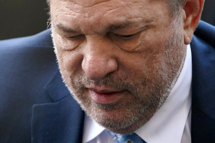 FILE PHOTO: Film producer Harvey Weinstein arrives at the New York Criminal Court during his ongoing sexual assault trial in the Manhattan borough of New York City