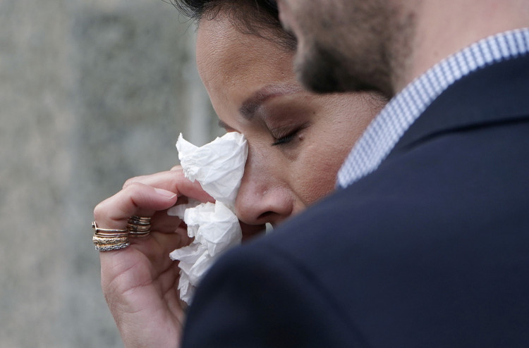 Film producer Harvey Weinstein's victim Tarale Wulff wipes her eye before speaks to the media after his sentencing at New York Criminal Court following his sexual assault trial in the Manhattan borough of New York City
