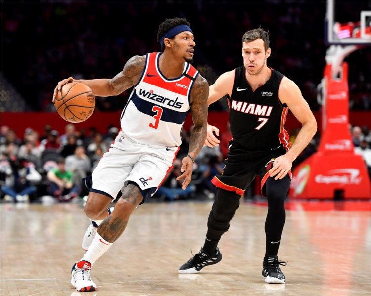 Washington Wizards guard Bradley Beal (3) dribbles past Miami Heat guard Goran Dragic (7)
