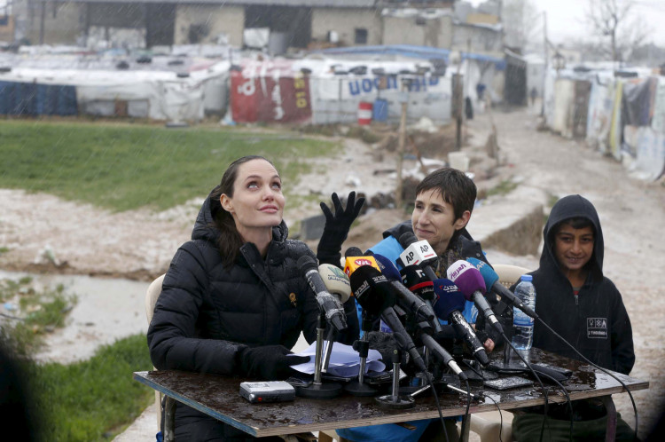 FILE PHOTO: United Nations High Commissioner for Refugees (UNHCR) Special Envoy Angelina Jolie reacts as it rains during a news conference during her visit to Syrian refugees in the Bekaa valley