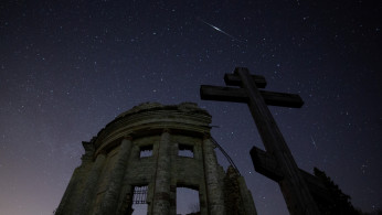 Stars are seen in the night sky during the Lyrid Meteor Shower over the ruins of Saint Trinity church in Leningrad Region