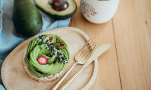 Avocado cake on a wooden table.