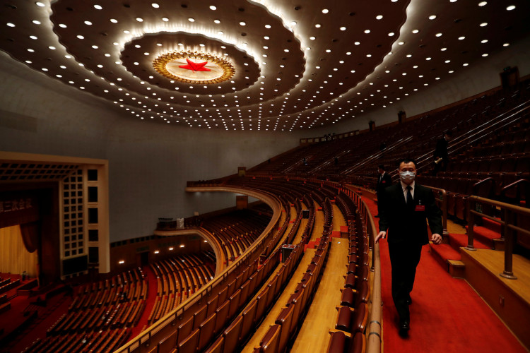 Security personnel inspect the venue at the end of the opening session of NPC in Beijing