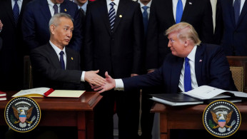 FILE PHOTO: Chinese Vice Premier Liu He and U.S. President Donald Trump shake hands after signing