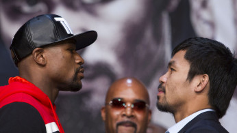 FILE PHOTO: Undefeated WBC/WBA welterweight champion Floyd Mayweather Jr of the U.S. and WBO welterweight champion Manny Pacquiao of the Philippines face off during a final news conference at the MGM
