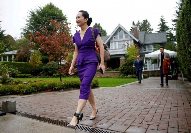 FILE PHOTO: FILE PHOTO: Huawei Technologies Chief Financial Officer Meng Wanzhou leaves her home