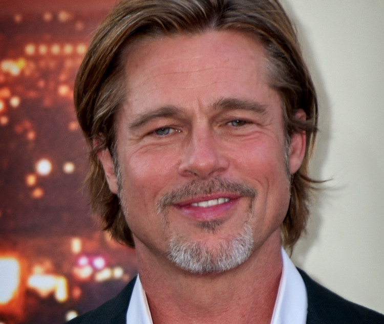 Brad Pitt allegedly flirting with Aussie reporter Renee Bragh. Photo by Toglenn/Wikimedia Commons