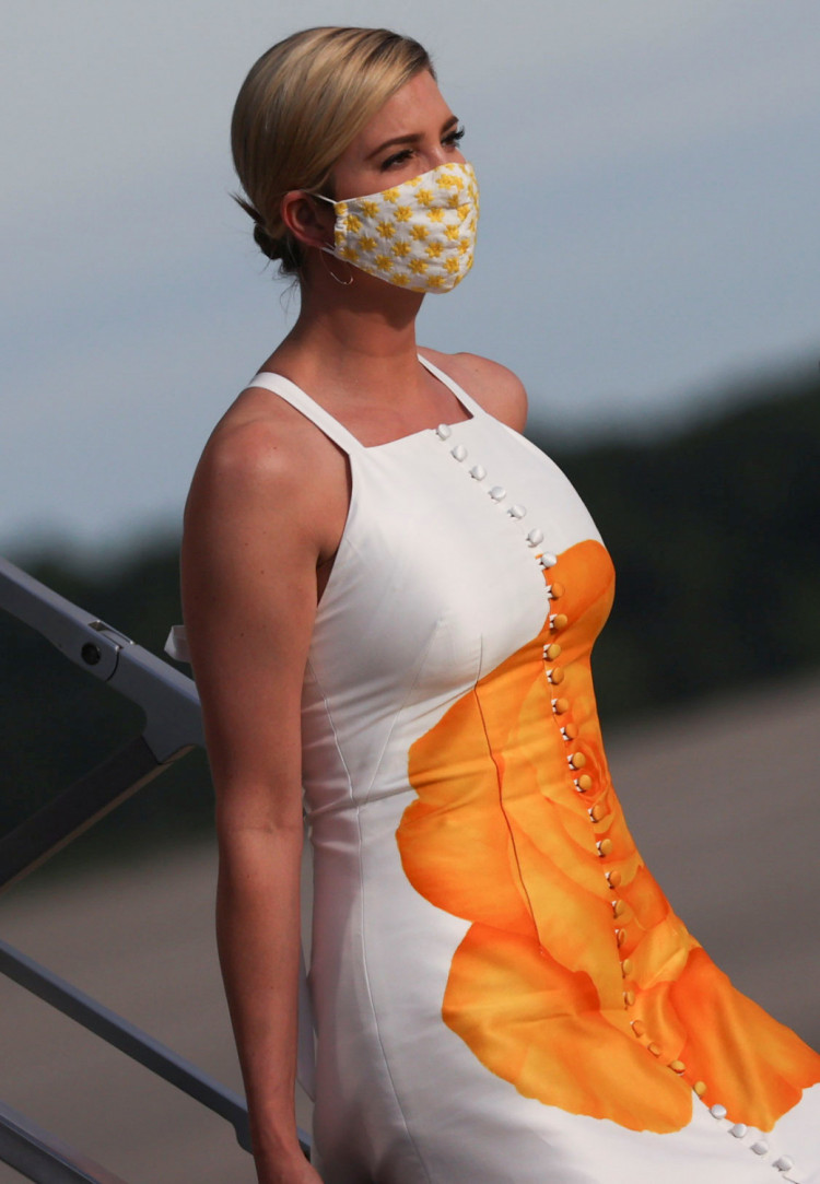 Ivanka Trump wears a protective face mask as she deplanes from Air Force One returning to Washington with her father U.S. President Donald Trump