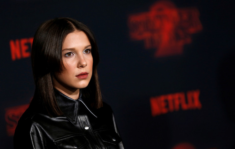 """Cast member Millie Bobby Brown poses at the premiere for the second season of the television series """"Stranger Things"""" in Los Angeles, California, U.S., October 26, 2017. REUTERS/Mario Anzuoni"""