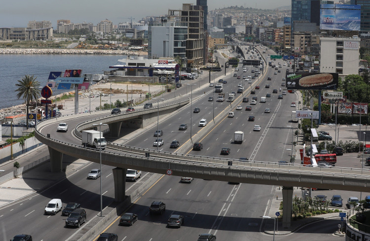 Cars drive along a highway in Jal el-Dib