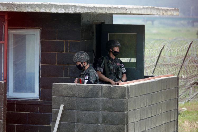 South Korean soldiers stand guard at their guard post near the demilitarized zone separating the two Koreas in Paju, South Korea, June 16, 2020.