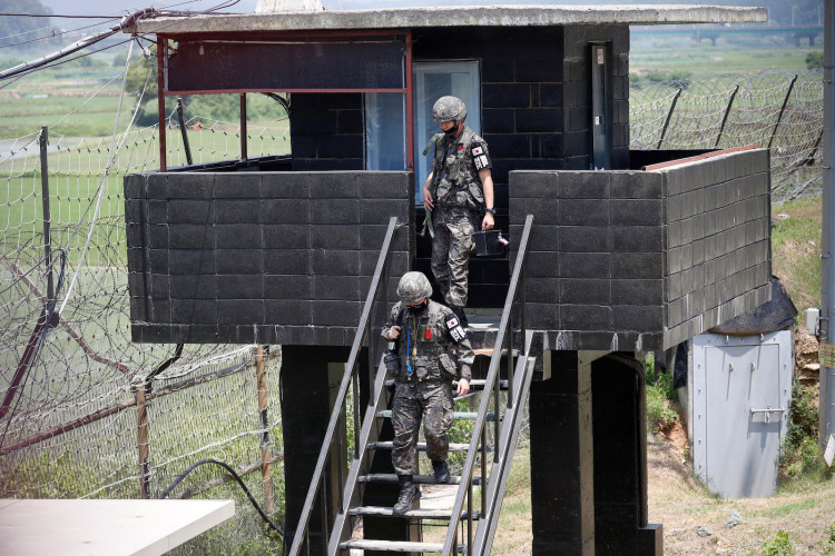 South Korean soldiers walk down from their guard post near the demilitarized zone separating the two Koreas in Paju, South Korea, June 16, 2020.