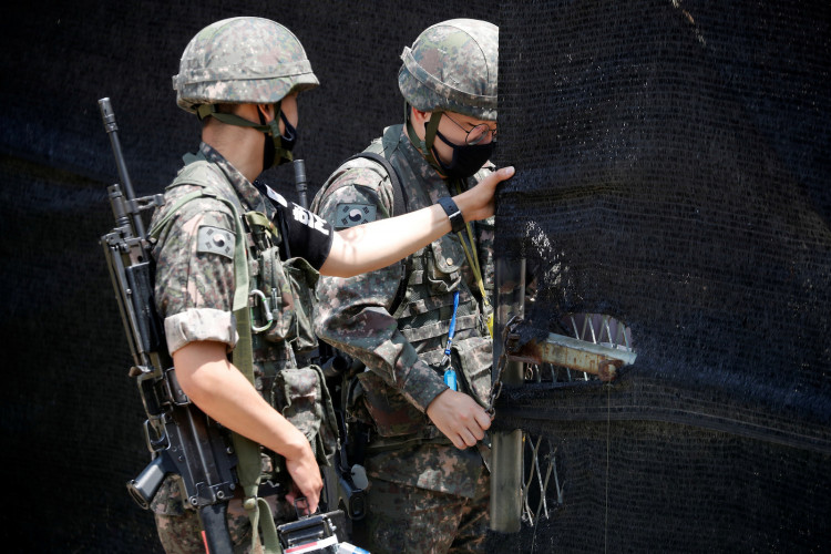 South Korean soldiers check an entrance of their guard post near the demilitarized zone separating the two Koreas in Paju, South Korea, June 16, 2020.