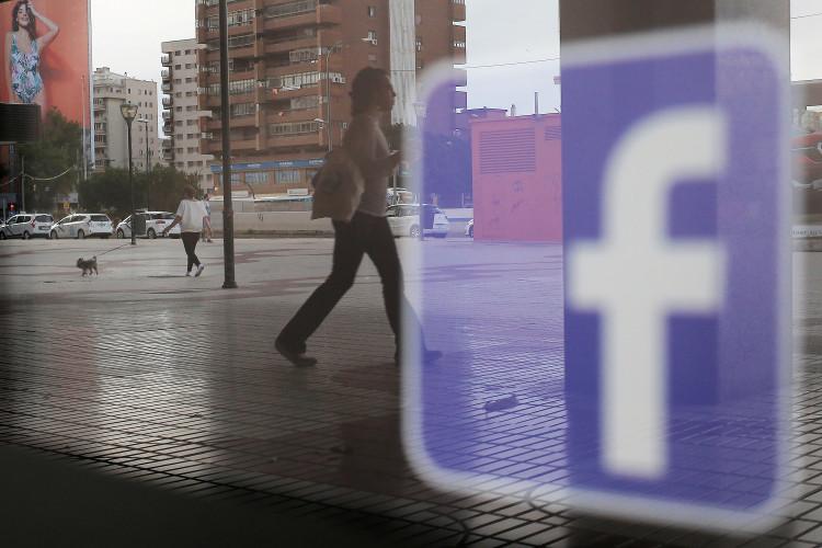 FILE PHOTO: Facebook logo is seen on a shop window in Malaga, Spain, June 4, 2018.