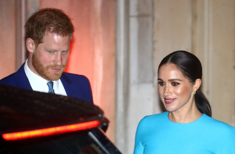 FILE PHOTO: Britain's Prince Harry and his wife Meghan, Duchess of Sussex, leave after attending the Endeavour Fund Awards in London