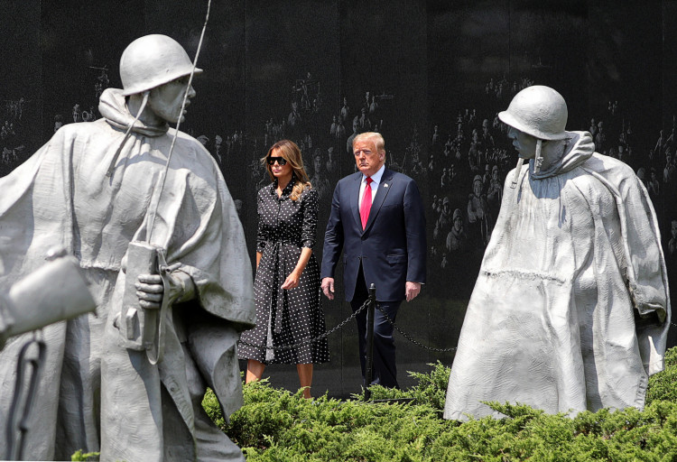 U.S. President Donald Trump and first lady Melania Trump walk past statues as they arrive for a wreath laying ceremony at the Korean War Veterans Memorial in Washington, U.S., June 25, 2020. REUTERS/Tom Brenner