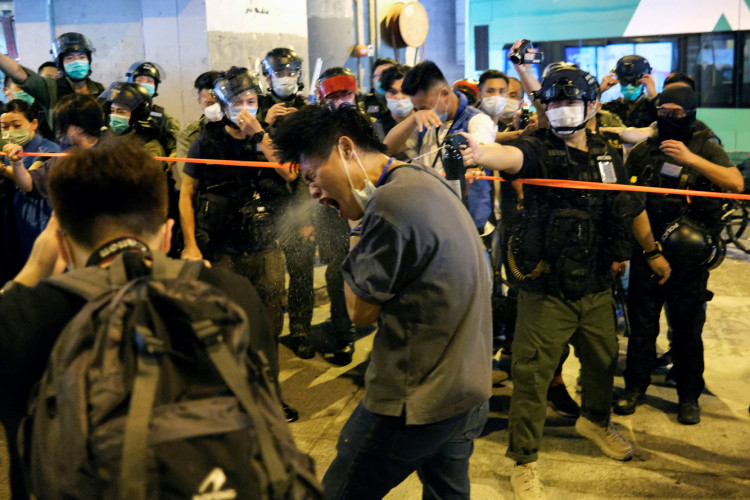 Police disperse pro-democracy protesters with pepper spray