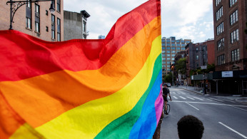Demonstrators march in support of LGBTQ pride and black lives matter movements