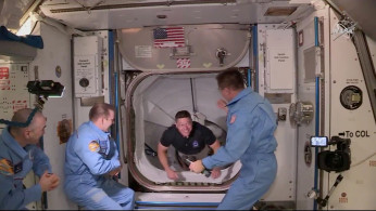 NASA astronaut Bob Behnken arrives at the International Space Station aboard SpaceX's Crew Dragon capsule in this still image taken from video May 31, 2020.