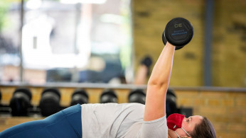 Rachel Aitken works out at Hone Fitness after indoor dining restaurants, gyms and cinemas re-opened under Phase 3 rules from coronavirus disease (COVID-19) restrictions