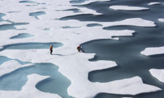The crew of the U.S. Coast Guard Cutter Healy, in the midst of their ICESCAPE mission, retrieves supplies dropped by parachute in the Arctic Ocean