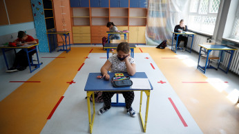 Children take part in a lesson after schools reopened for grades 1-3 amid the coronavirus disease (COVID-19) lockdown in Warsaw, Poland