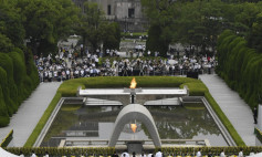 The Atomic Bomb Dome is seen from the venue holding a ceremony to mark the 75th anniversary